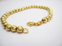 צמיד זהב כדורים מבריקים