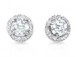 עגילי יהלום עם טבעת יהלומים מסביב לאבן המרכזית יהלום או טופז כחול