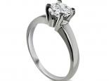 טבעת זהב בשיבוץ ארבע שיניים עם יהלום גדול 1 קארט