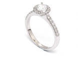 """טבעת יהלום חצי קראט עם שיבוץ סביב היהלום ועל הזרועות - """"SATURN"""""""